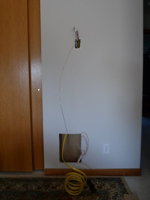 Holes in wall, with wires coming out of them, during upgrade to low-voltage thermostat.